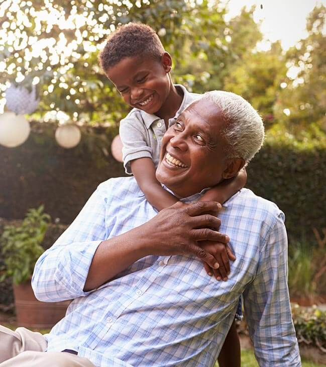Older man and young child having fun outside