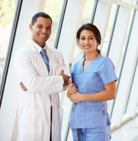 Doctors in bright hallway of medical facility