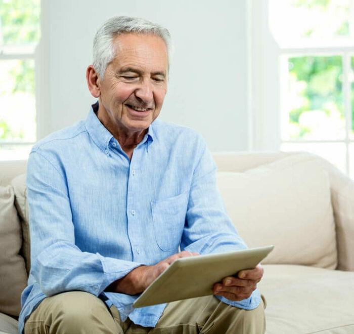 Senior man looking at tablet